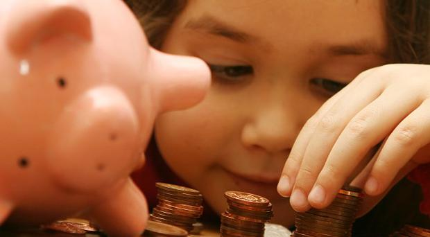 Parents spend more than 10,000 pounds on average a year on raising their child, according to a report
