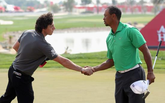 ABU DHABI, UNITED ARAB EMIRATES - JANUARY 26: Rory McIlroy of Northern Ireland shakes hands with Tiger Woods of the USA on the ninth green during the first round of The Abu Dhabi HSBC Golf Championship at Abu Dhabi Golf Club on January 26, 2012 in Abu Dhabi, United Arab Emirates. (Photo by Andrew Redington/Getty Images)