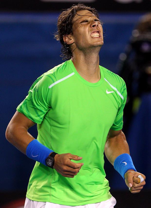 MELBOURNE, AUSTRALIA - JANUARY 26: Rafael Nadal of Spain celebrates winning his semifinal match against Roger Federer of Switzerland during day eleven of the 2012 Australian Open at Melbourne Park on January 26, 2012 in Melbourne, Australia. (Photo by Cameron Spencer/Getty Images)