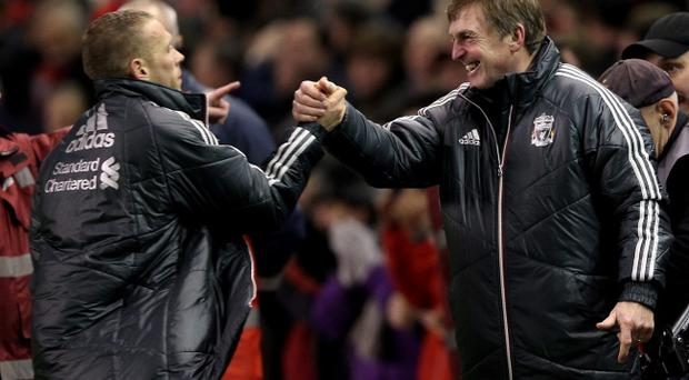 LIVERPOOL, ENGLAND - JANUARY 25: Liverpool Manager Kenny Dalglish embraces Craig Bellamy at the end of the Carling Cup Semi Final Second Leg match between Liverpool and Manchester City at Anfield on January 25, 2012 in Liverpool, England. (Photo by Alex Livesey/Getty Images)