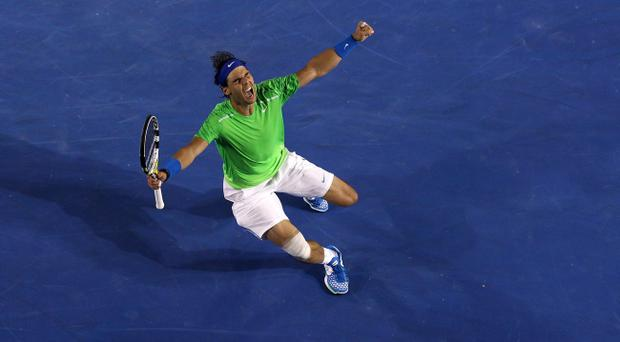 MELBOURNE, AUSTRALIA - JANUARY 26: Rafael Nadal of Spain celebrates winning his semifinal match against Roger Federer of Switzerland during day eleven of the 2012 Australian Open at Melbourne Park on January 26, 2012 in Melbourne, Australia. (Photo by Quinn Rooney/Getty Images)
