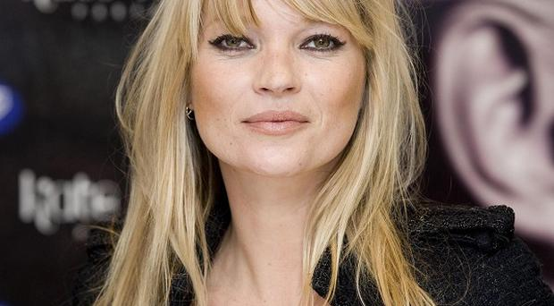 Kate Moss says she's not ready to reveal all in an autobiography just yet