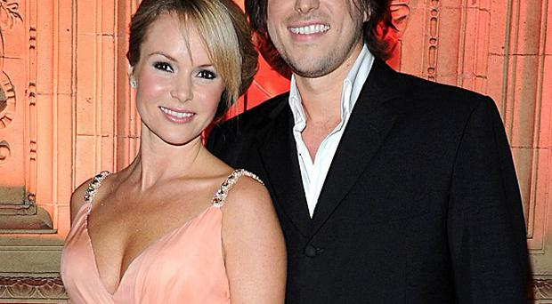 Amanda Holden's husband Chris Hughes has thanked the medics who helped her