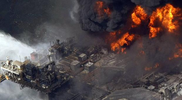 The Deepwater Horizon oil rig burns in the Gulf of Mexico (AP)