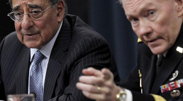 US Defence Secretary Leon Panetta and Joint Chiefs chairman Gen Martin E Dempsey outline the proposed spending cuts at the Pentagon (AP)