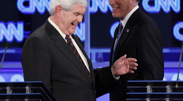 Republican presidential candidates Newt Gingrich and Mitt Romney at the debate in Jacksonville, Florida (AP)
