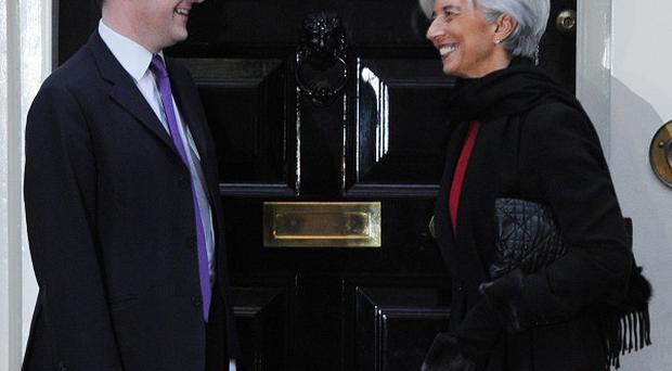 Christine Lagarde, head of the IMF, has given her backing to Chancellor George Osborne's austerity package