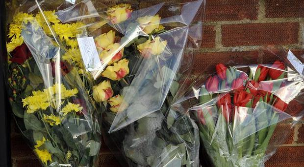 Flowers left near the home of Edward Syrad, who died after being tied up during a burglary