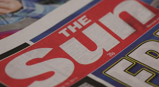 Four former employees of The Sun and a serving police officer were arrested as part of the phone-hacking inquiry