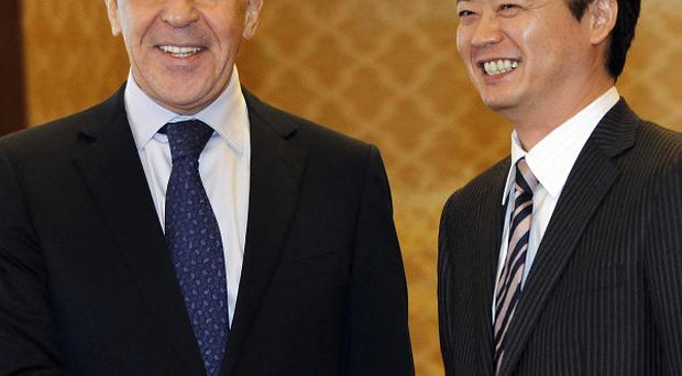 Russian Foreign Minister Sergey Lavrov shakes hands with his counterpart Koichiro Gemba prior to their meeting in Tokyo (AP)
