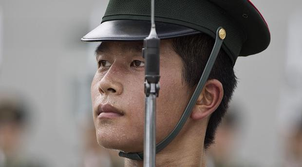 China's ruling Communist Party has ultimate control over the country's rapidly modernising military (AP)