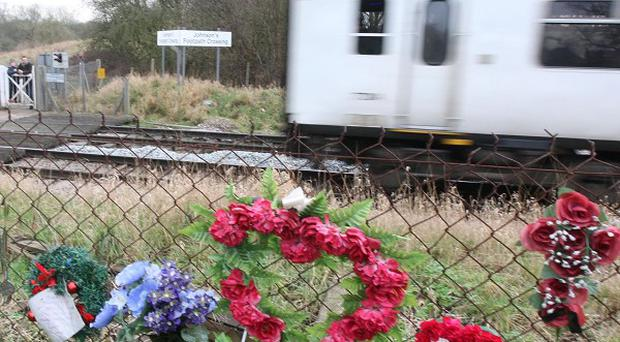 Flowers at the Johnson's Footpath crossing in Bishop's Stortford after a 15-year-old girl died after being hit by a train