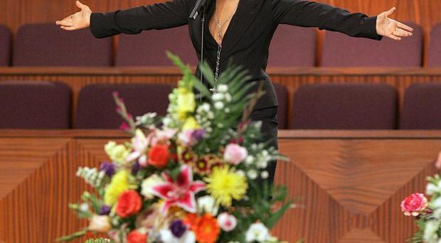 Christina Aguilera performs at the funeral for Etta James (AP)