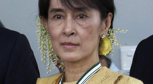 Aung San Suu Kyi has devoted much of her life to the struggle against authoritarian rule in Burma (AP)