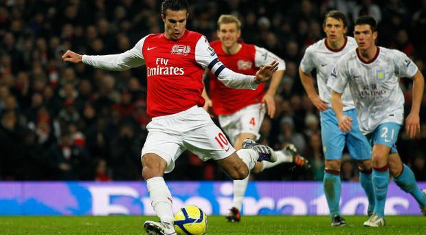 LONDON, ENGLAND - JANUARY 29: Robin van Persie of Arsenal scores their third goal from the penalty spot during the FA Cup with Budweiser Fourth Round match between Arsenal and Aston Villa at Emirates Stadium on January 29, 2012 in London, England. (Photo by Paul Gilham/Getty Images)