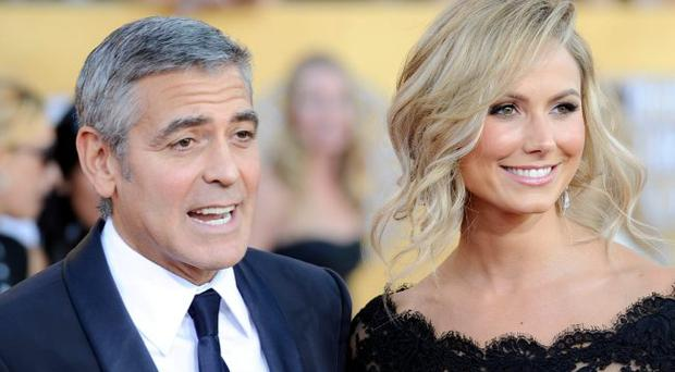 George Clooney and Stacy Keibler arrive at the 18th Annual Screen Actors Guild Awards at The Shrine Auditorium on January 29, 2012