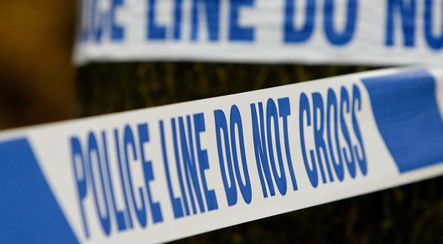 Greater Manchester Police have charged a man after two suspicious devices were found in a flat