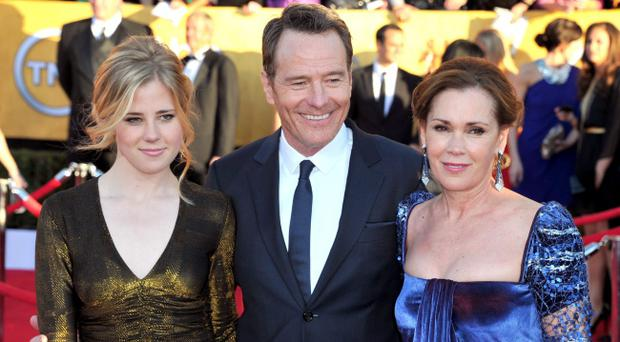 Taylor Cranston, Bryan Cranston, and Robin Dearden arrive at the 18th Annual Screen Actors Guild Awards at The Shrine Auditorium on January 29, 2012 in Los Angeles, California. (Photo by Alberto E. Rodriguez/Getty Images)