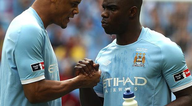 Vincent Kompany and Micah Richards
