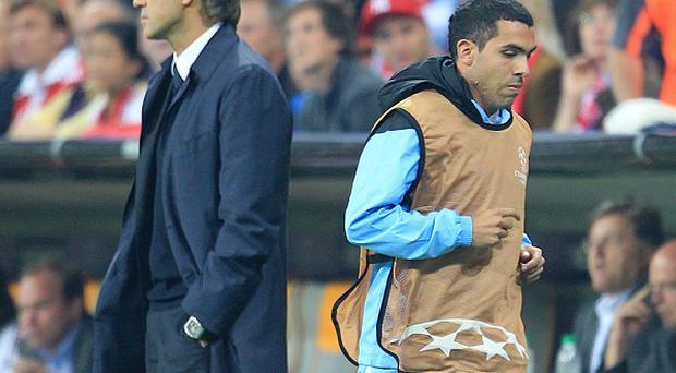Carlos Tevez (right)
