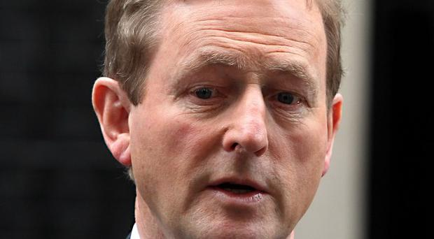 Taoiseach Enda Kenny was accused of giving mixed messages to audiences over the financial crisis
