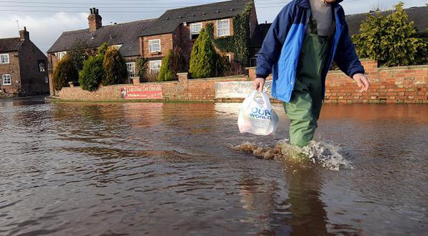 Fears about the amount of money available to maintain and improve flood defences have been raised by a committee of MPs