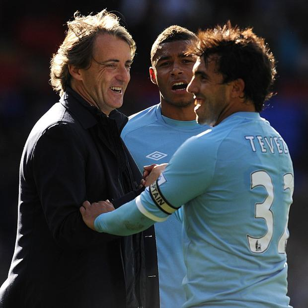 Carlos Tevez (right) and Roberto Mancini (left)