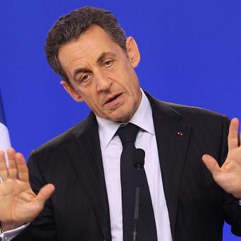 French president Nicolas Sarkozy has vowed to introduce a financial transactions tax if he is re-elected (AP)