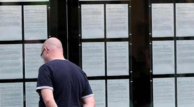 A man looks in the window of an FAS employment centre in Dublin as unemployment in the eurozone hits a new high