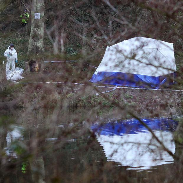 Police at the scene around Reed Pond in Canterbury, Kent, following the discovery of two bodies
