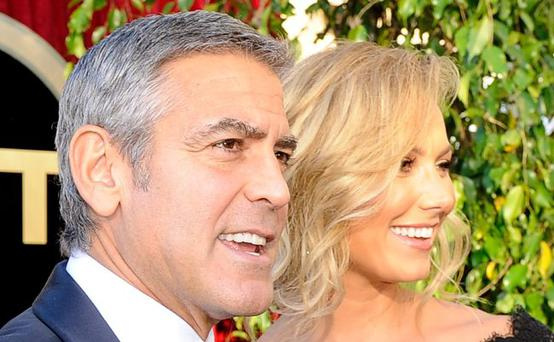 George Clooney and Stacy Keibler arrive at the 18th Annual Screen Actors Guild Awards at The Shrine Auditorium on January 29, 2012 in Los Angeles, California.