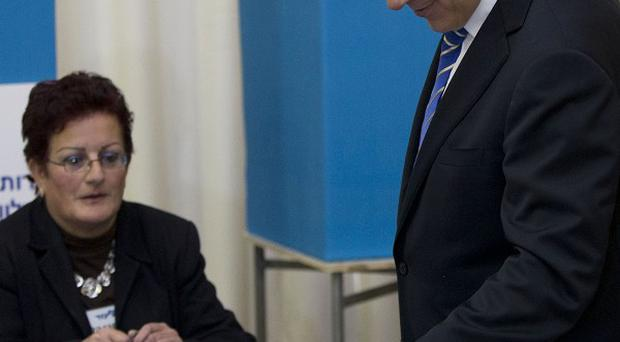 Israel's Prime Minister Benjamin Netanyahu casts his vote during Likud Party primary elections in Jerusalem (AP)