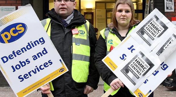 Striking workers outside their offices in Belfast during their 24-hour walkout in a row over privatisation
