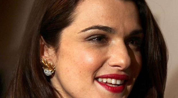 The watchdog has banned a L'Oreal advert featuring a digitally retouched image of Rachel Weisz