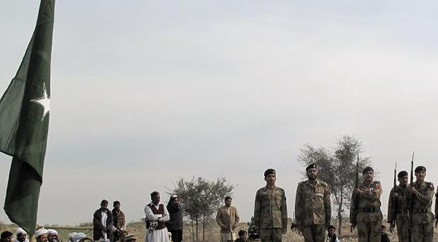 Pakistani soldiers pay tribute to a colleague who lost his life during clashes with militants in Paharpur, 32 miles north of Dera Ismail Khan (AP)