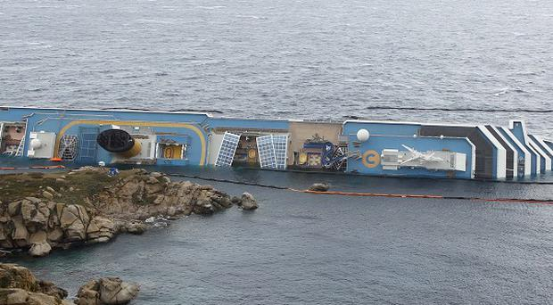 French prosecutors have begun an investigation into the grounding of the cruise ship Costa Concordia (AP )