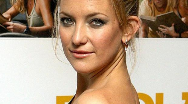 Kate Hudson is swapping rom coms for action in her next role