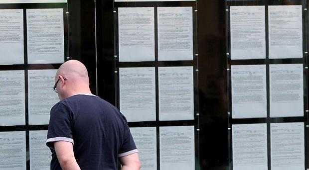 A man looks in the window at a FAS employment centre in Dublin