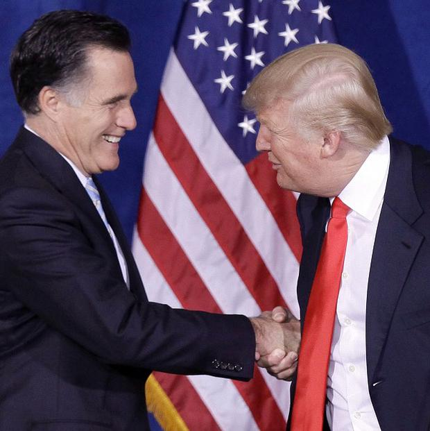Donald Trump, right, has endorsed the campaign of Mitt Romney (AP)