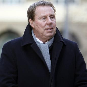 Tottenham Hotspur manager Harry Redknapp arrives at Southwark Crown Court in London, as he stands trial on tax evasion charges (AP)