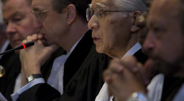 Presiding judge Hisashi Owada, third from right looking up, reads the verdict of the International Court of Justice in The Hague(AP)