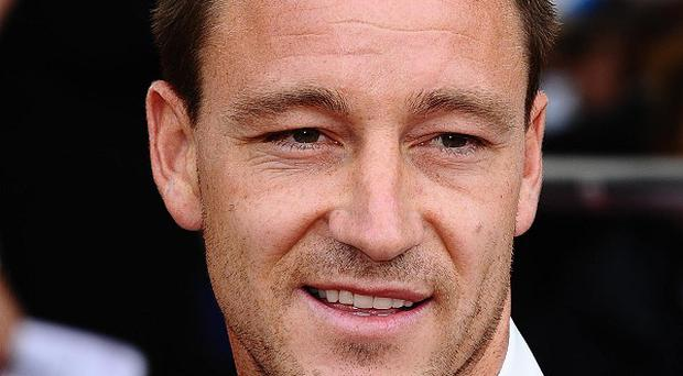 Chelsea defender John Terry has been stripped of the England football captaincy as he awaits racial abuse charges