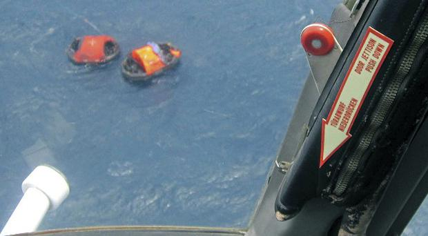 Two life rafts from the MV Rabaul Queen, seen from a helicopter, float in the open waters off Papua New Guinea (AP)