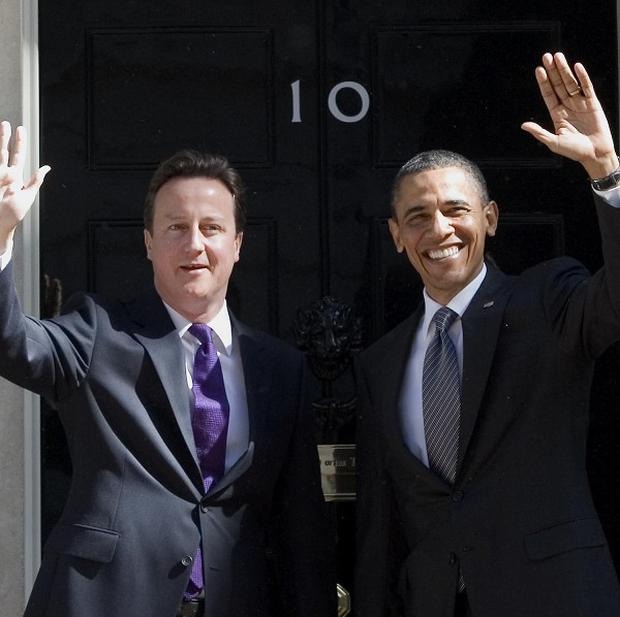 David Cameron, pictured with Barack Obama in London last May, will visit Washington next month