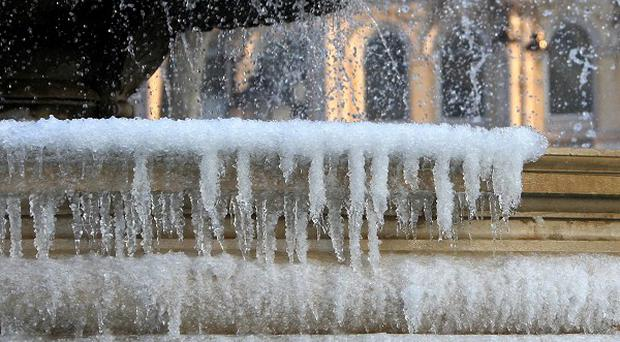 Icicles form on the fountain in Trafalgar Square, central London, as Britain freezes during a cold snap