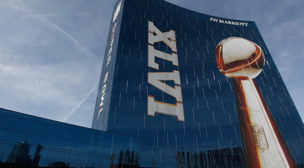 Official signage of the Lombardi Trophy and Super Bowl XLVI is seen on the exterior of the J.W. Marriott Indianapolis, which is serving as the Super Bowl Media center, is seen prior to Super Bowl XLVI between the New York Giants and the New England Patriots on February 3, 2012 in Indianapolis, Indiana
