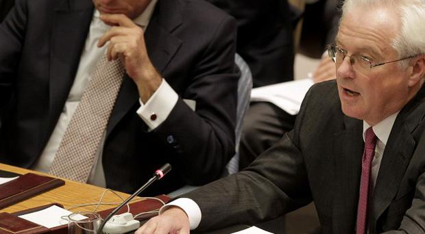 Vitaly Churkin, Russia's ambassador to the UN, is opposing a call for Syria's President Bashar Assad to step down (AP)