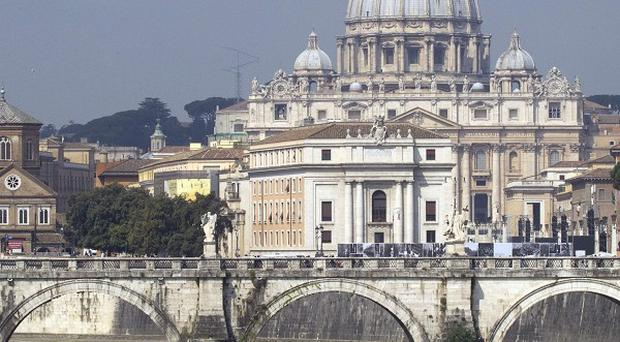Italian police divers are searching the Tiber river after a man allegedly threw his young son off a bridge (AP)