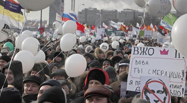 Demonstrators gather for a massive protest against Prime Minister Vladimir Putin's rule in Bolotnaya square in Moscow (AP)
