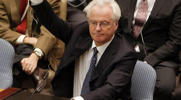 Russia's Vitaly Churkin vetoes a UN Security Council draft resolution backing a call for Syrian President Bashar Assad to step down (AP)
